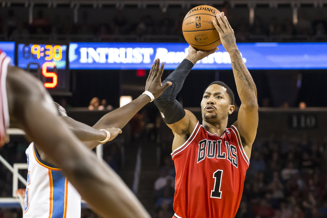 Hi-res-185680814-derrick-rose-of-the-chicago-bulls-shoots-against-the_crop_650