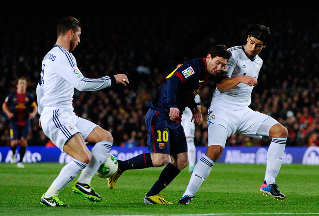 Hi-res-162786430-lionel-messi-of-fc-barcelona-duels-for-the-ball-with_crop_650x440