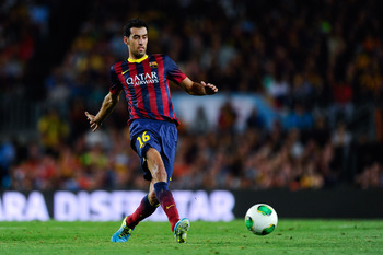 Hi-res-179551086-sergio-busquets-of-fc-barcelona-runs-with-the-ball_display_image