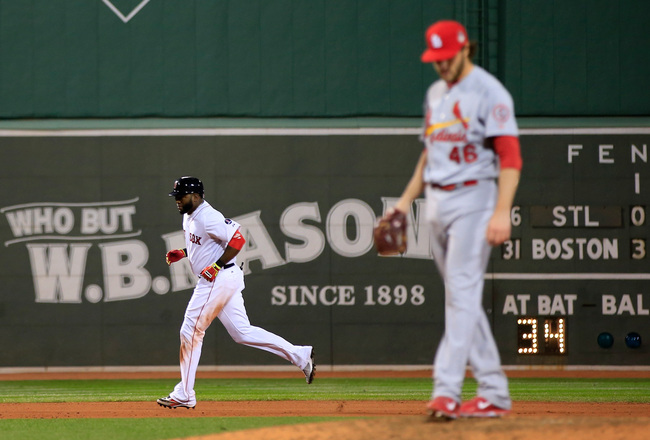 Hi-res-185680538-david-ortiz-of-the-boston-red-sox-rounds-the-bases_crop_650x440