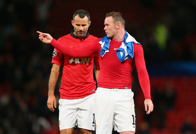 Hi-res-185658579-wayne-rooney-of-manchester-united-speaks-to-team-mate_crop_650