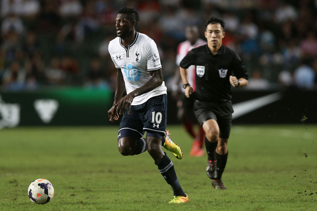 Hi-res-174396393-emmanuel-adebayor-of-tottenham-hotspur-looks-to-pass_crop_650