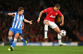 Hi-res-185655326-javier-hernandez-of-manchester-united-beats-inigo_display_image