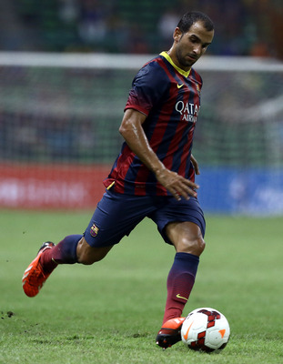 Hi-res-175964022-martin-montoya-of-barcelona-fc-runs-with-the-ball_display_image