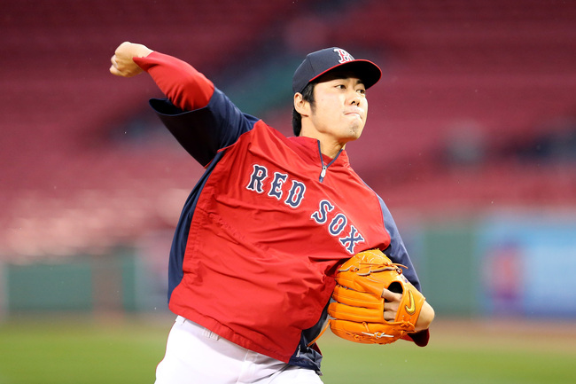 Hi-res-185592487-koji-uehara-of-the-boston-red-sox-warms-up-during-team_crop_650