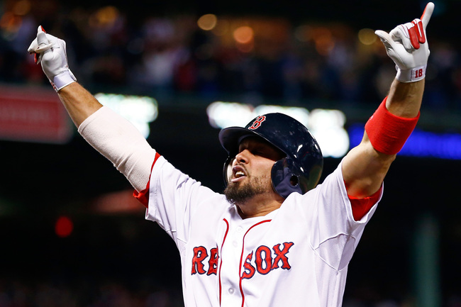 Hi-res-185379784-shane-victorino-of-the-boston-red-sox-celebrates-after_crop_650