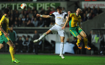 Hi-res-185728950-swansea-player-michu-beats-aleksei-kozlov-to-the-ball_display_image