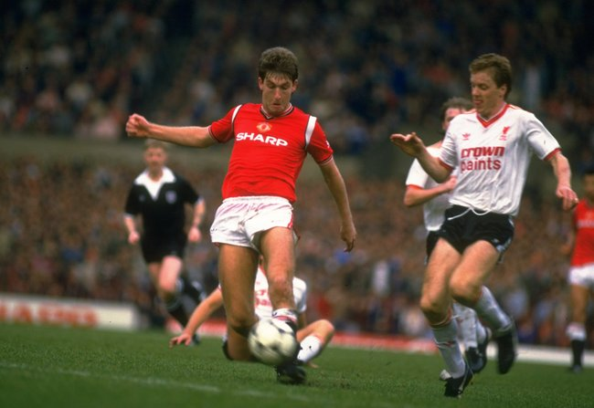 Hi-res-1628655-oct-1985-steve-nicholl-of-liverpool-comes-in-to-tackle_crop_650