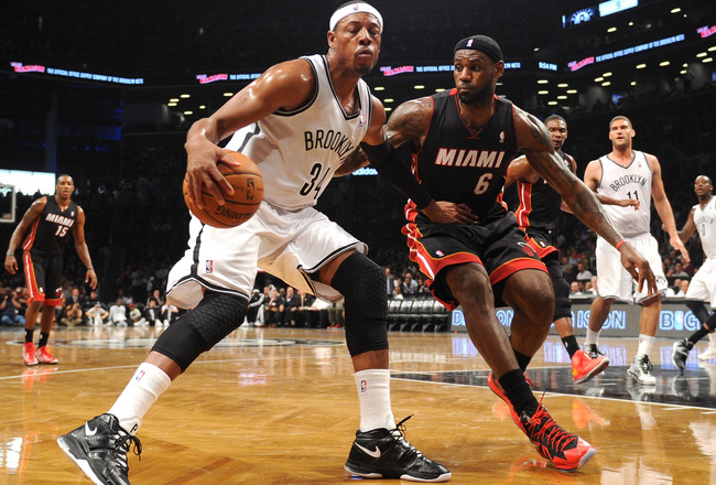Hi-res-185161505-paul-pierce-of-the-brooklyn-nets-drives-against-lebron_crop_650x440