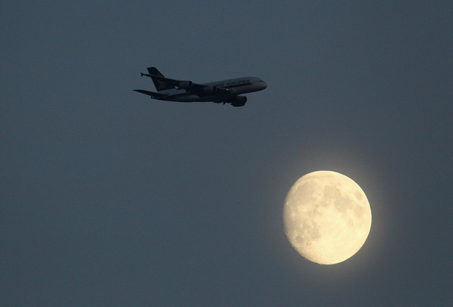 Hi-res-104312333-singapore-airlines-a380-aeroplane-flies-past-the-moon_crop_650x440
