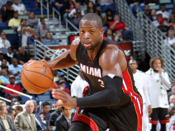 Hi-res-185690373-dwyane-wade-of-the-miami-heat-dribbles-up-the-floor_display_image