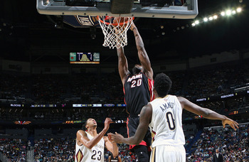Hi-res-185690386-greg-oden-of-the-miami-heat-dunks-the-ball-against-the_display_image