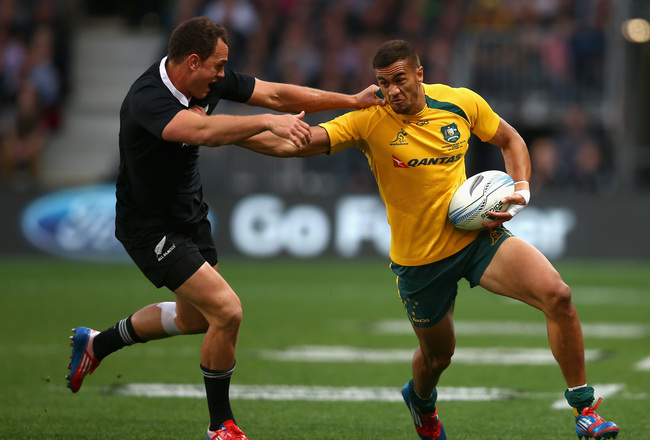 Hi-res-185342187-peter-beetham-of-the-wallabies-is-tackled-by-israel_crop_650x440