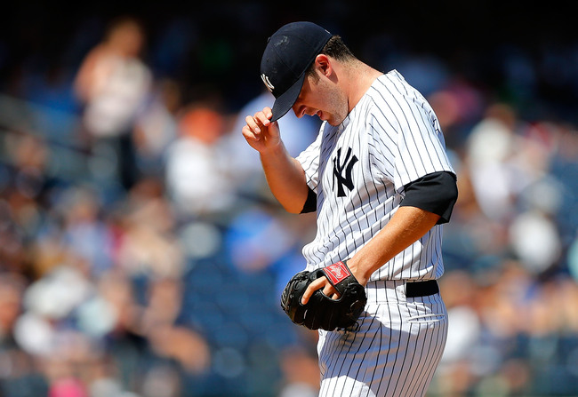 Hi-res-176566822-phil-hughes-of-the-new-york-yankees-stands-on-the-mound_crop_650