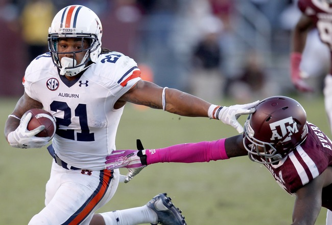 Hi-res-185369479-tre-mason-of-the-auburn-tigers-rushes-against-deshazor_crop_650x440