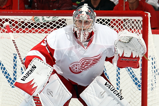 Hi-res-183657086-jimmy-howard-of-the-detroit-redwings-crouches-in-the_crop_650