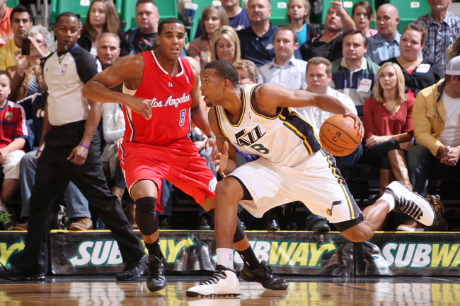 SALT LAKE CITY, UT - OCTOBER 12:  Dominic McGuire #8 of the Utah Jazz drives against Brandon Davies #8 of the Los Angeles Clippers at Energy Solutions Arena on October 12, 2013 in Salt Lake City, Utah. NOTE TO USER: User expressly acknowledges and agrees