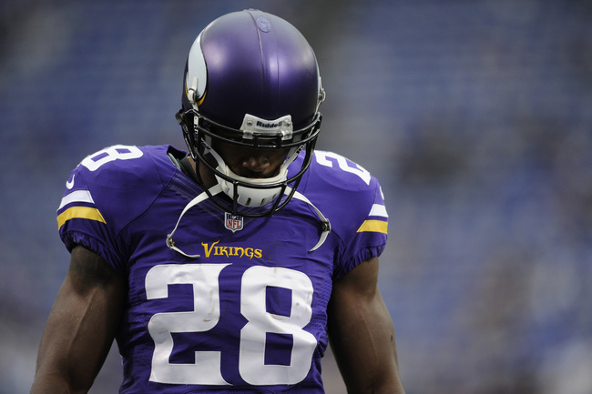 Hi-res-184407326-adrian-peterson-of-the-minnesota-vikings-looks-on_crop_650