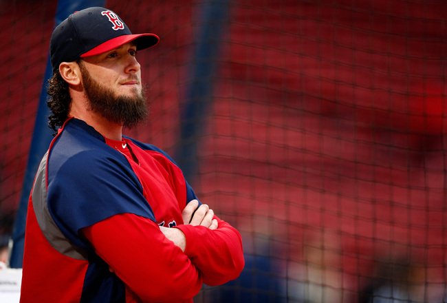 Hi-res-185661883-jarrod-saltalamacchia-of-the-boston-red-sox-stands-on_crop_650x440