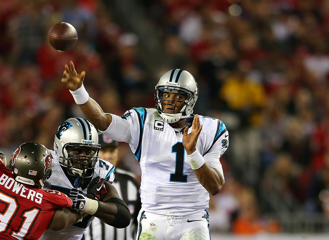 Hi-res-185769742-cam-newton-of-the-carolina-panthers-passes-during-a_crop_650
