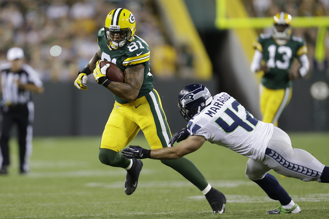 Hi-res-177563711-andrew-quarless-of-the-green-bay-packers-runs-for-yards_crop_650