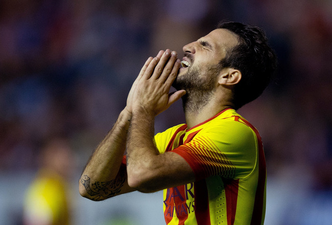 Hi-res-185357484-cesc-fabregas-of-fc-barcelona-reacts-as-he-failed-to_crop_650x440