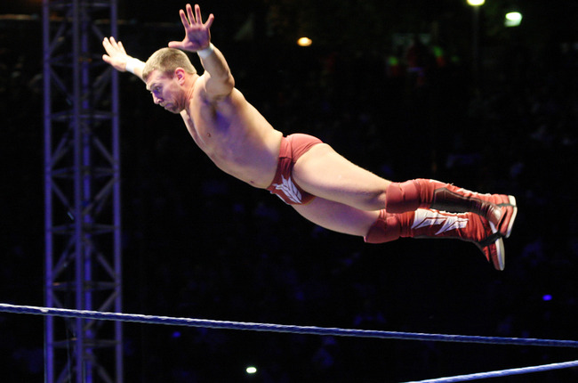Hi-res-118553582-superstar-daniel-bryan-flys-off-the-ropes-during-the_crop_650