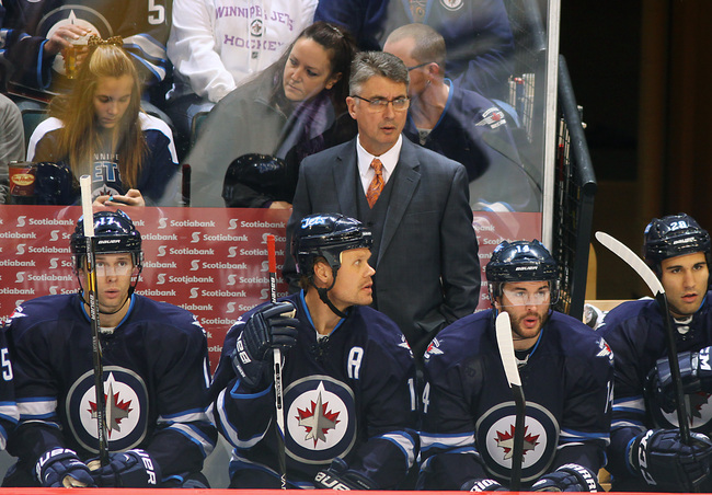 Hi-res-185448644-head-coach-claude-noel-of-the-winnipeg-jets-looks-on_crop_650