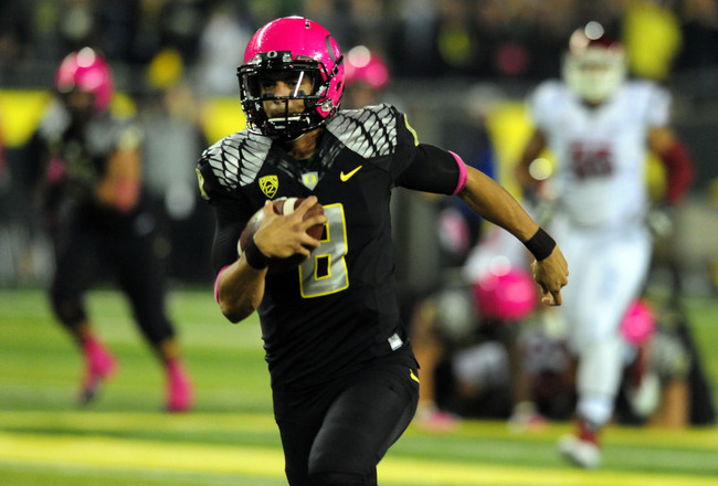 Hi-res-185376831-quarterback-marcus-mariota-of-the-oregon-ducks-runs-for_crop_650x440