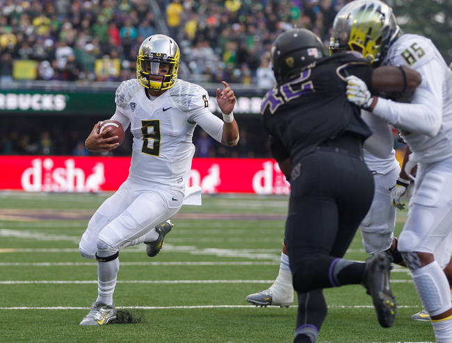 Hi-res-184240465-quarterback-marcus-mariota-of-the-oregon-ducks-rushes_crop_650