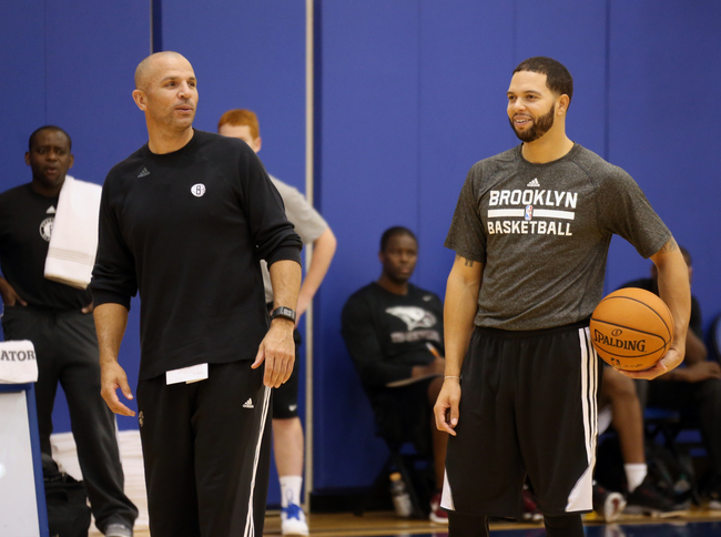 Hi-res-183101321-head-coach-jason-kidd-and-deron-williams-of-the_crop_650