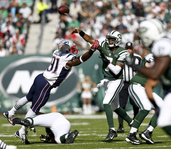 Hi-res-185422252-geno-smith-of-the-new-york-jets-passes-under-pressure_display_image