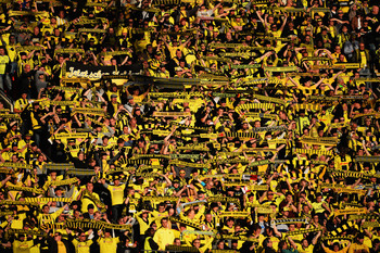 Hi-res-169475112-general-view-of-borussia-dortmund-fans-during-the-uefa_display_image