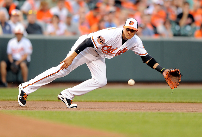 Hi-res-150075677-manny-machado-of-the-baltimore-orioles-dives-for-and_crop_650x440
