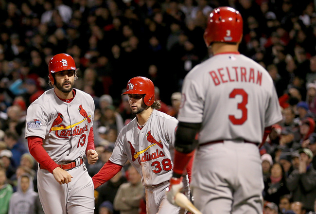 Hi-res-185770322-matt-carpenter-celebrates-with-carlos-beltran-and-pete_crop_650x440