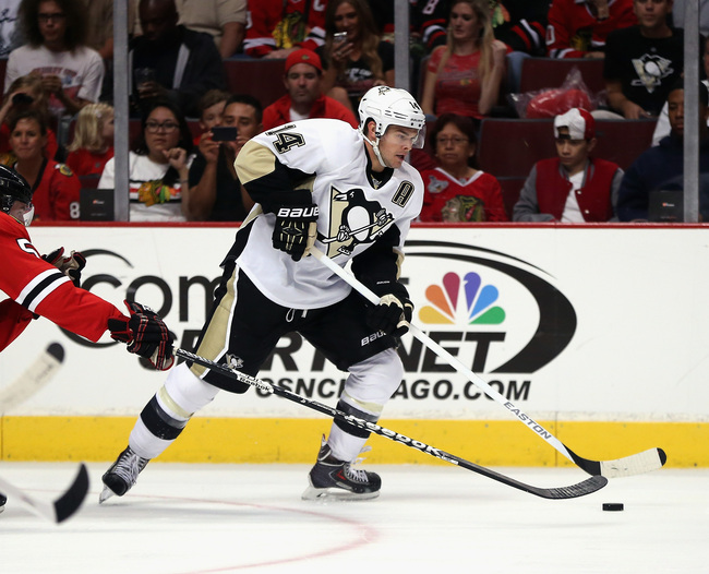 Hi-res-181210811-chris-kunitz-of-the-pittsburgh-penguins-passes-against_crop_650