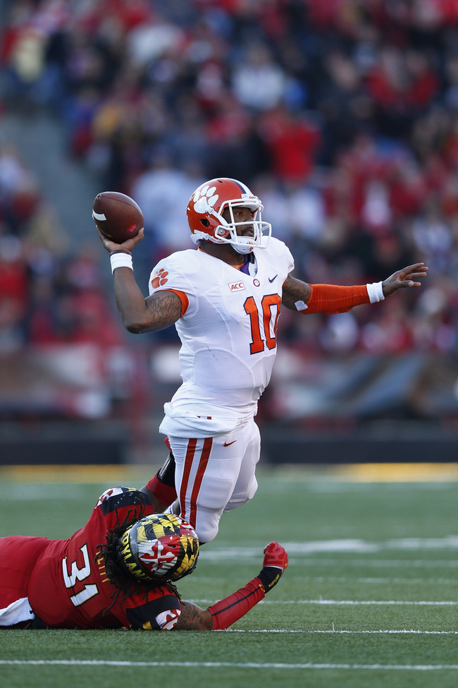 Hi-res-185960810-tajh-boyd-of-the-clemson-tigers-tries-to-throw-a-pass_crop_650