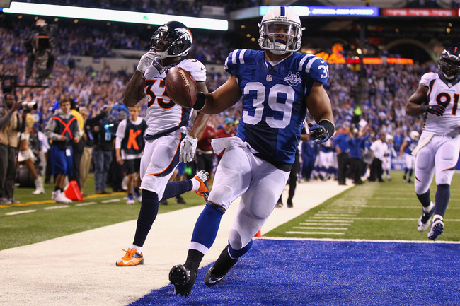 Hi-res-185451577-stanley-havili-of-the-indianapolis-colts-scores-a_crop_650