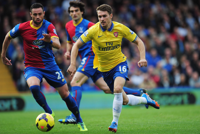 Hi-res-185913987-aaron-ramsey-of-arsenal-takes-the-ball-past-damien_crop_650