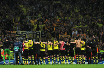 Hi-res-185587787-borussia-dortmund-players-celebrate-victory-at-the_display_image
