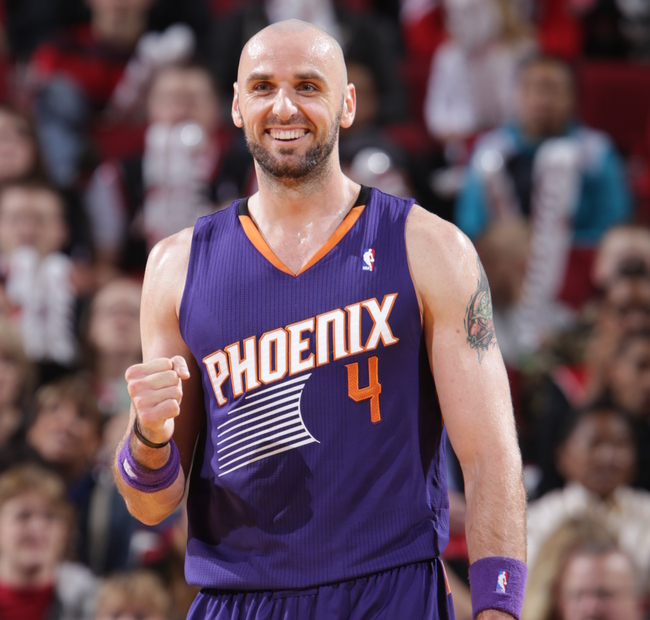 Hi-res-184066154-marcin-gortat-of-the-phoenix-suns-walks-up-court_crop_650