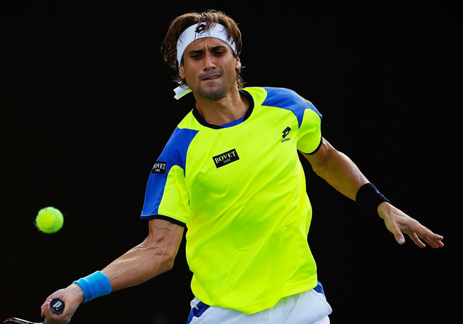 Hi-res-183939483-david-ferrer-of-spain-returns-a-shot-to-florian-mayer_crop_650