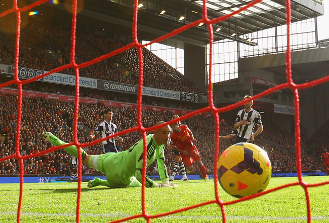 Hi-res-185923545-luis-suarez-of-liverpool-scores-the-opening-goal-during_crop_650x440