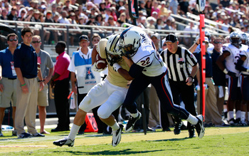 Hi-res-185958320-worton-of-the-ucf-knights-is-tackled-by-andrew-adams-of_display_image