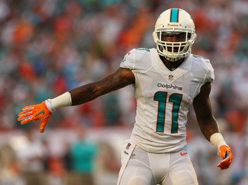 Hi-res-181594341-mike-wallace-of-the-miami-dolphins-looks-on-during-a_display_image