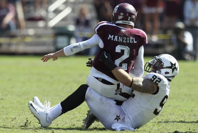 Hi-res-185942969-johnny-manziel-of-the-texas-a-m-aggies-is-sacked-by_crop_650