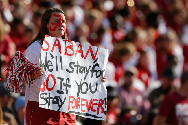 Hi-res-185960827-fan-holds-up-a-sign-for-head-coach-nick-saban-of-the_crop_650