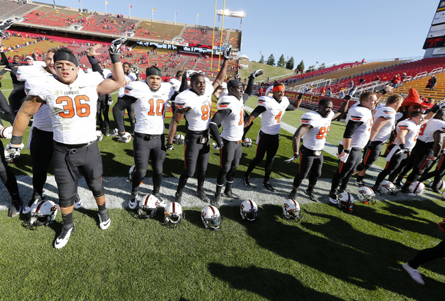 Hi-res-185958096-the-oklahoma-state-cowboys-celebrate-after-defeating_crop_650x440
