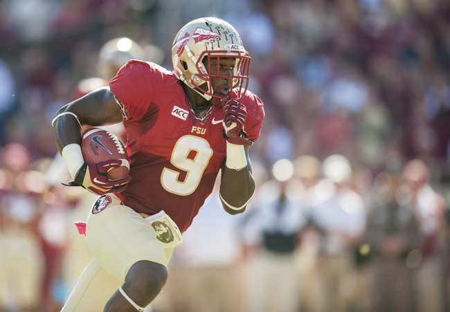 Hi-res-185954684-karlos-williams-of-the-florida-state-seminoles-runs-to_crop_650