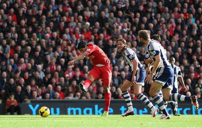 Hi-res-185917905-luis-suarez-of-liverpool-scores-the-opening-goal-during_crop_650
